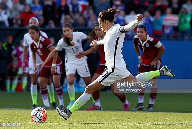 Carli Lloyd of USA kicks a penality kick ans scores against Cecilia Santiago of Mexico in the second half during the United States v Mexico Group A...