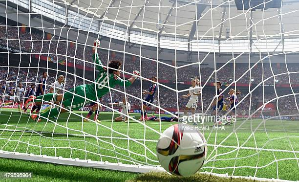 Carli Lloyd of USA scores her team's first goal despite the efforts of Japan goalkeeper Ayumi Kaihori during FIFA Women's World Cup 2015 Final...