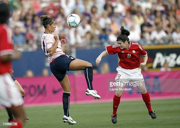 Carli Lloyd#11 of the USA Women's Soccer Team controls the ball against Diana Matheson of the Canadian Women's Soccer Team on May 12 2007 at the...