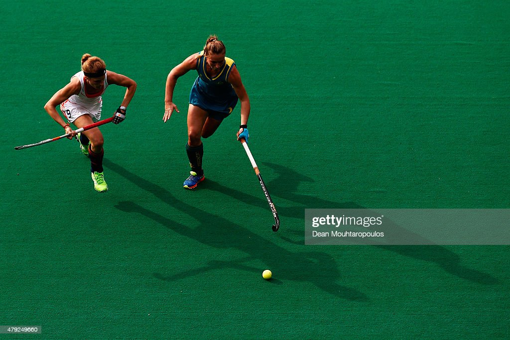 Carlien Dirkse Van Den Heuvel of the Netherlands battles for the ball with <a gi-track='captionPersonalityLinkClicked' href=/galleries/search?phrase=Mariah+Williams+-+Field+Hockey+Player&family=editorial&specificpeople=8378875 ng-click='$event.stopPropagation()'>Mariah Williams</a> of Australia during the Fintro Hockey World League Semi-Final match between Netherlands and Australia held at KHC Dragons Gemeentepark Stadium on July 2, 2015 in Brasschaat, Belgium.