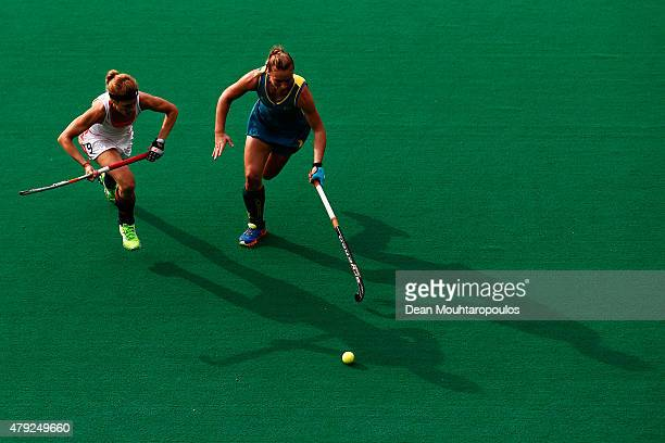 Carlien Dirkse Van Den Heuvel of the Netherlands battles for the ball with Mariah Williams of Australia during the Fintro Hockey World League...