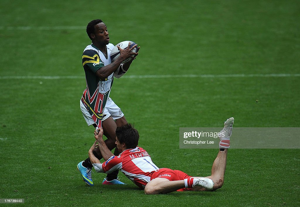 Carlin Isles of San Francisco is held back by Max Hobbs of Gloucester during the Plate Semi Final match between Gloucester Rugby and San Francisco in the World Club 7's at Twickenham Stadium on August 18, 2013 in London, England.