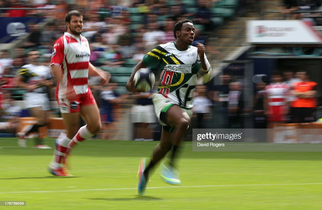 Carlin Isles of San Francisco races away with the ball in the match against Gloucester during the World Club 7's at Twickenham Stadium on August 18, 2013 in London, England.