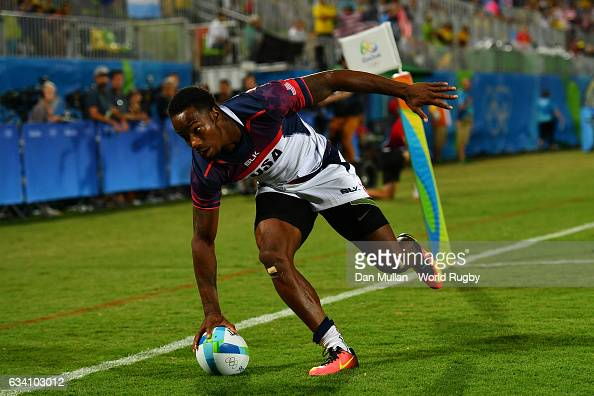 Carlin Isles of the United States crosses the line for a try during the Men's Rugby Sevens Pool A match between the United States and Brazil on Day 4...