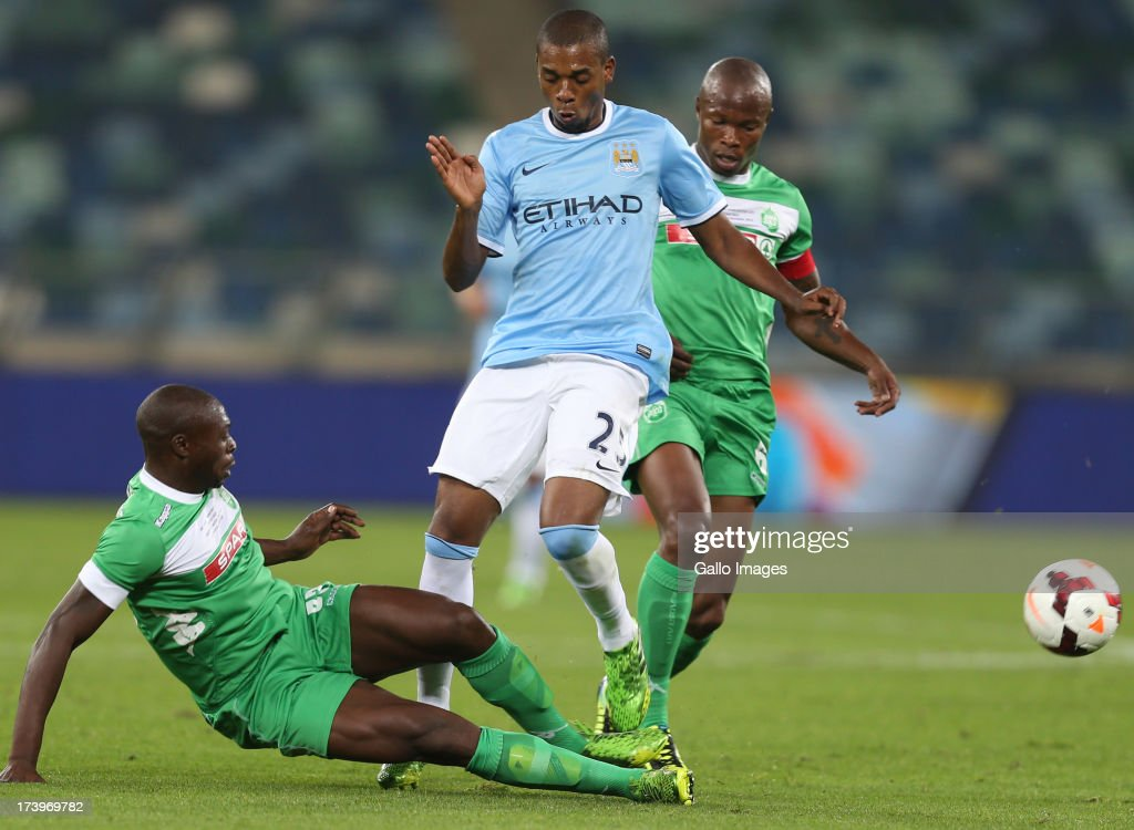 Carlington Nyadombo of AmaZulu with a tackle on Fernandinho of Manchester City during the Nelson Mandela Football Invitational match between AmaZulu and Manchester City at Moses Mabhida Stadium on July 18, 2013 in Durban, South Africa.