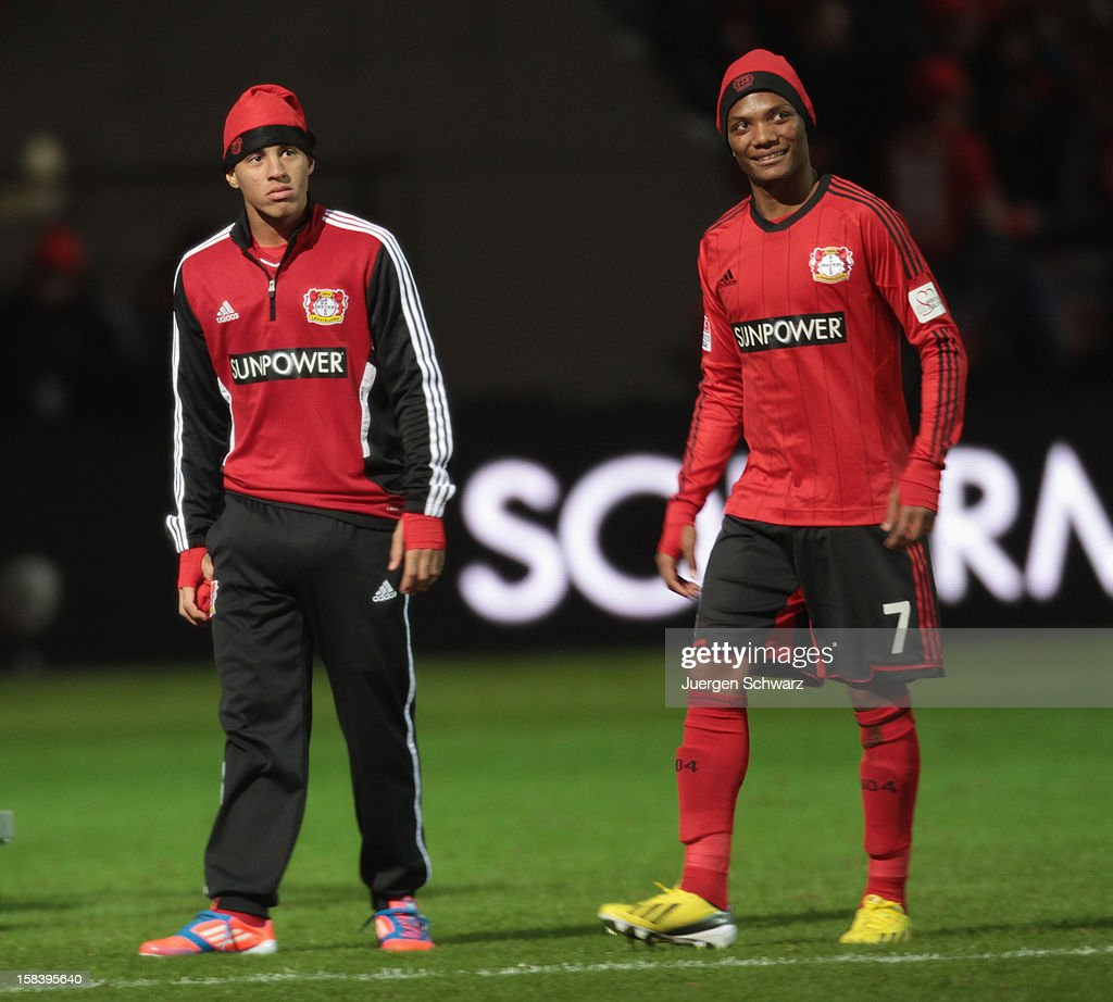 Carlinhos (L) and <a gi-track='captionPersonalityLinkClicked' href=/galleries/search?phrase=Junior+Fernandes&family=editorial&specificpeople=8988393 ng-click='$event.stopPropagation()'>Junior Fernandes</a> of Leverkusen walk on the pitch after the Bundesliga match between Bayer Leverkusen and Hamburger SV at BayArena on December 15, 2012 in Leverkusen, Germany.