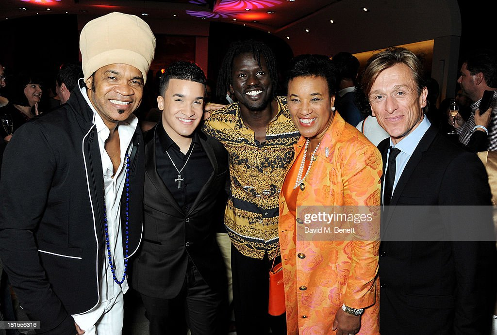 Carlinhos Brown, Jahmene Douglas, Emmanuel Jal, Baroness Patricia Scotland and Peace One Day founder Jeremy Gilley celebrate 'Peace One Day' at the Peace One Day concert after party held at the Hilton on September 21, 2013 in The Hague, Netherlands.