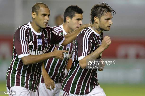 Carlinhos Eduardo and Rafael Sobis of Fluminense celebrates a scored goal during the match between Fluminense and Goias a as part of Brazilian...