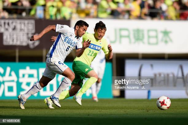 Carlinhos of Tokushima Vortis and Naotake Hanyu of JEF United Chiba compete for the ball during the JLeague J2 match between JEF United Chiba and...