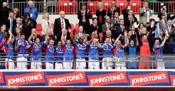 Carlisle captain Paul Thirlwell lifts the trophy after winning the the Johnstone's Paint trophy Final between Brentford and Carlisle United at...