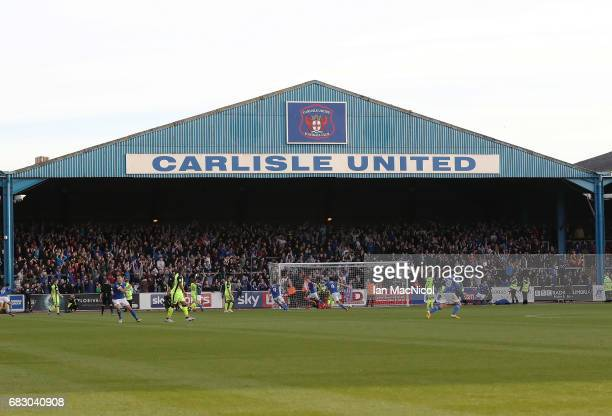 Carlisle players celebrate after Shaun Miller of Carlisle United scores his team's third goal during the Sky Bet League Two match between Carlise...