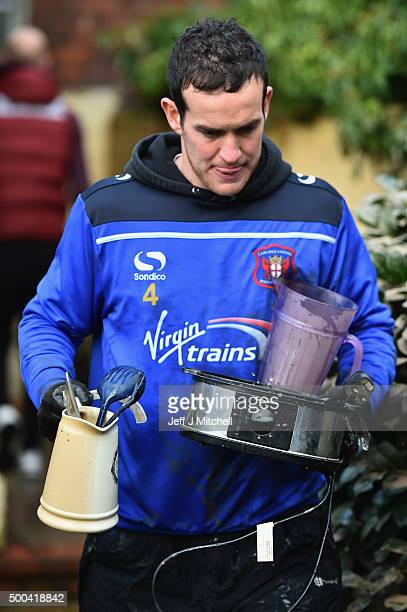 Carlisle United football player Luke Joyce helps residents in Warwick road clear processions as they return to their properties after Storm Desmond...