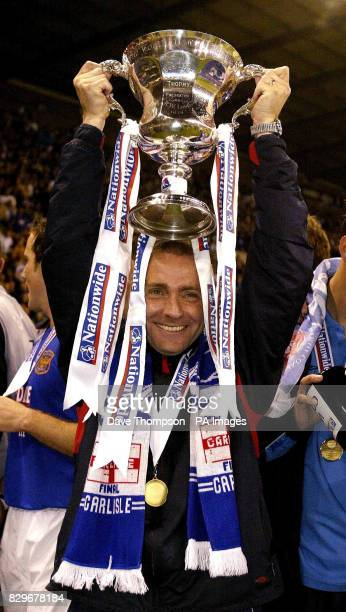 Carlisle United manager Paul Simpson with the trophy after his side beat Stevenage Borough