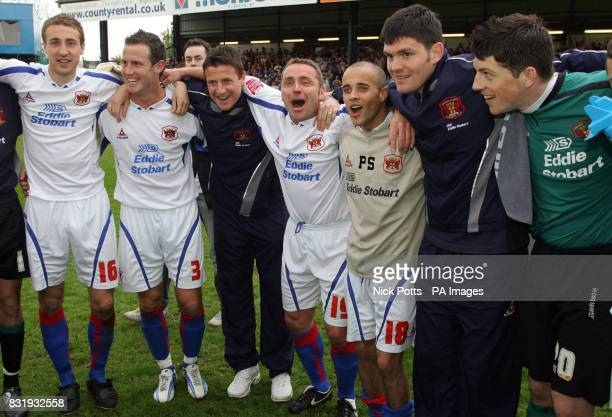 Carlisle United player manager Paul Simpson leads the celebration after the CocaCola League Two match against Stockport at Edgeley Park Stockport