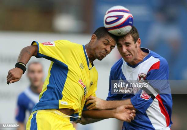 Carlisle United's Danny Livesy and Leed's United's Jermaine Beckford during the CocaCola Football League One match at Brunton Park Carlisle