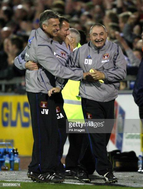 Carlisle United's manager John Ward and his staff celebrate the win against Leed's United at the end of the game in the CocaCola Football League One...