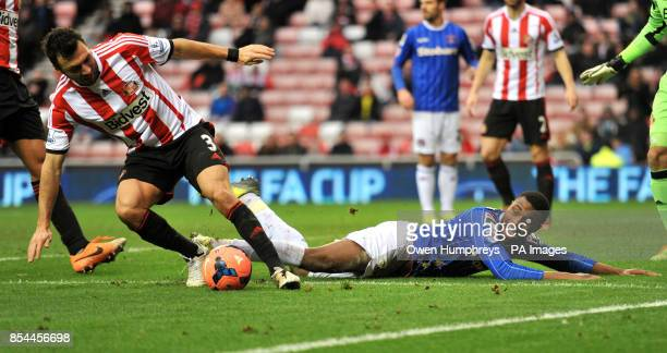 Carlisle's David Amoo attempts to claim a penalty after a tackle in the box by Sunderland's Andrea Dossena during the FA Cup Third Round match at The...
