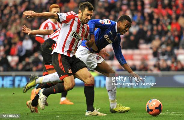 Carlisle's David Amoo trys to claim a penalty after a tackle in the box by Sunderland's Andrea Dossena during the FA Cup Third Round match at The...