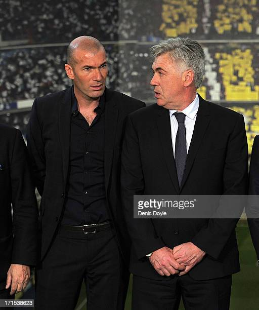 Carlo Ancelotti chats with former Real Madrid player Zinedine Zidane during Ancelotti's presentation as Real's new head coach at Estadio Bernabeu on...