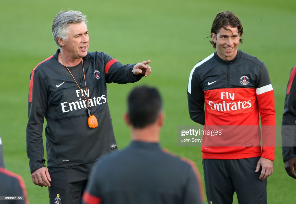 <a gi-track='captionPersonalityLinkClicked' href=/galleries/search?phrase=Carlo+Ancelotti&family=editorial&specificpeople=226747 ng-click='$event.stopPropagation()'>Carlo Ancelotti</a>, coach of PSG, gives his instructions with Maxwell looking on before the Paris Saint Germain training session held at the Aspire Academy for Sports Excellence on January 1, 2013 in Doha, Qatar.