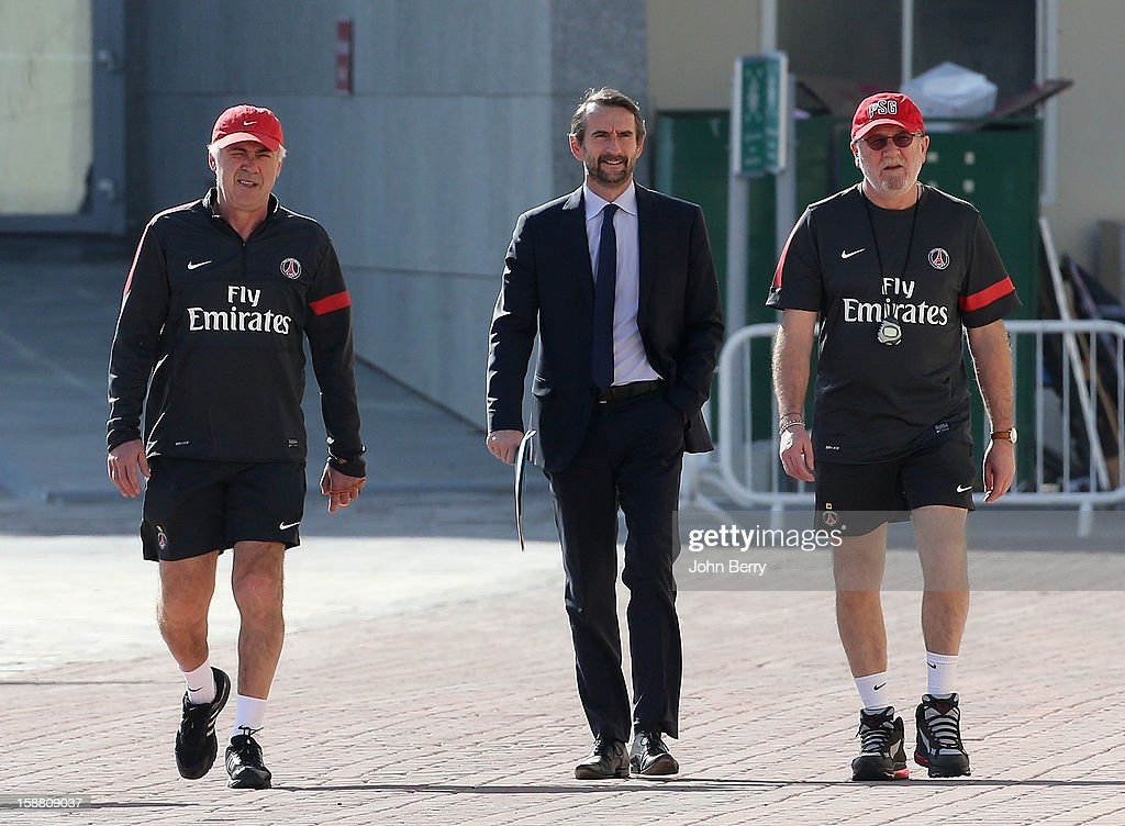 Carlo Ancelotti, coach of PSG, Jean-Claude Blanc, Director of PSG, and Giovanni Mauri, fitness coach of PSG arriving at the Paris Saint Germain training camp held at the Aspire Academy for Sports Excellence on December 29, 2012 in Doha, Qatar.