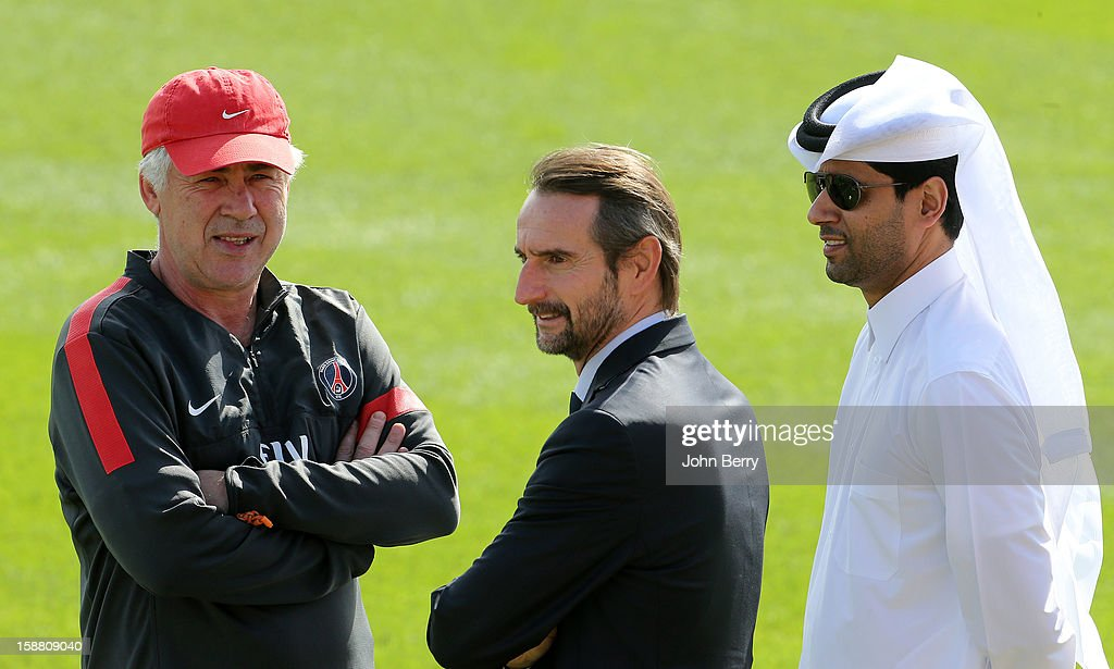 Carlo Ancelotti, coach of PSG, Jean-Claude Blanc, Director of PSG, and Nasser Al-Khelaifi, President of PSG talking at the end of the Paris Saint Germain training session held at the Aspire Academy for Sports Excellence on December 29, 2012 in Doha, Qatar.