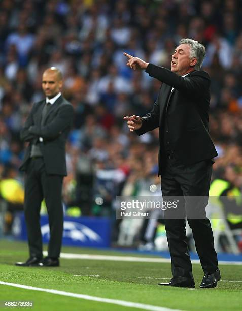 Carlo Ancelotti coach of Real Madrid gives instructions with Josep Guardiola coach of Bayern Muenchen during the UEFA Champions League semifinal...