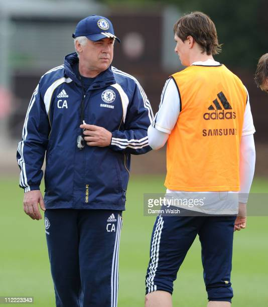 Carlo Ancelotti Fernando Torres of Chelsea during a training session at the Cobham Training Ground on April 15 2011 in Cobham England