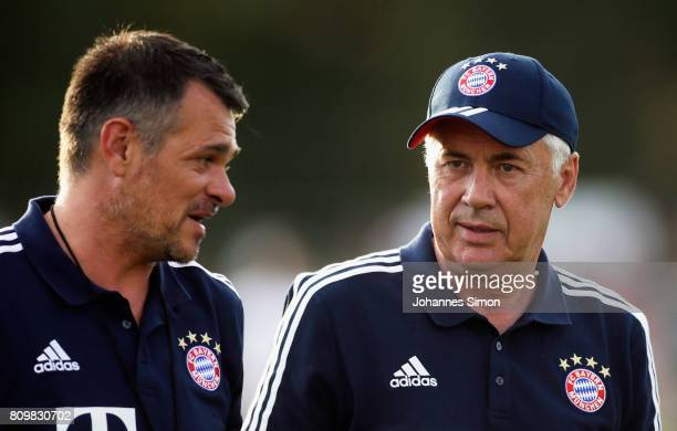 Carlo Ancelotti head coach of Bayern and assistant coach Willy Sagnol leave the pitch after the preseason friendly match between BCF Wolfratshausen...