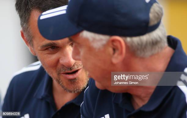 Carlo Ancelotti head coach of Bayern and assistant coach Willy Sagnol chat together prior to the preseason friendly match between BCF Wolfratshausen...
