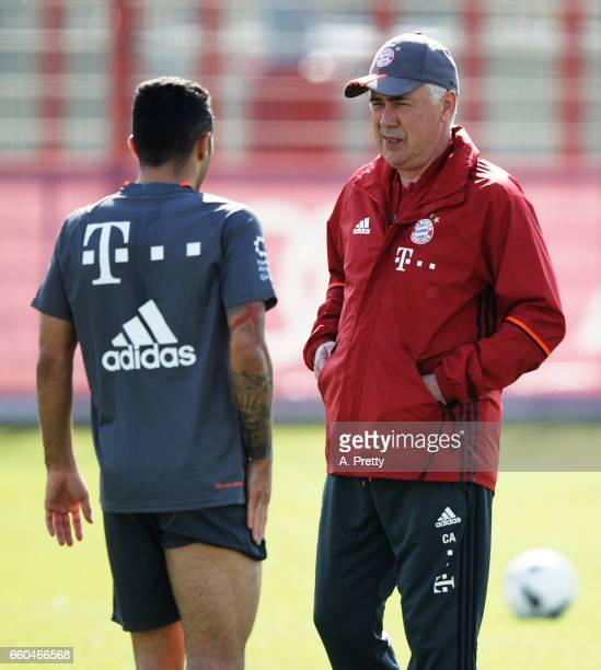 Carlo Ancelotti head coach of Bayern Muenchen has a chat to Thiago during training at Saebener Strasse training ground on March 30 2017 in Munich...