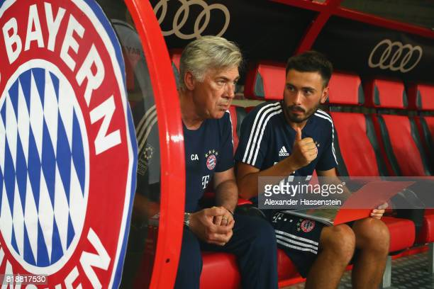 Carlo Ancelotti head coach of Bayern Muenchen tolks to his son and assistent coach Davide Ancelotti prior to the Audi Football Summit 2017 match...