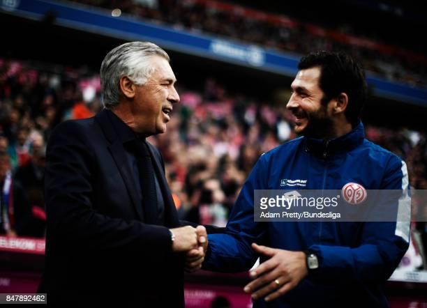 Carlo Ancelotti head coach of Bayern Munich greets Sandro Schwarz head coach of FSV Mainz 05before the Bundesliga match between FC Bayern Muenchen...