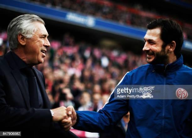 Carlo Ancelotti head coach of Bayern Munich greets Sandro Schwarz head coach of FSV Mainz 05 before the Bundesliga match between FC Bayern Muenchen...