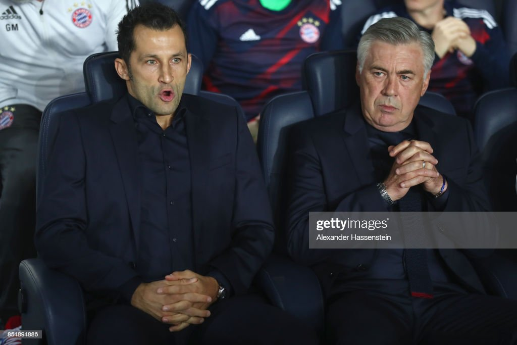 Carlo Ancelotti, head coach of FC Bayern Muenchen looks on with Hasan Salihamidzic (L), sporting director of Muenchen prior to the UEFA Champions League group B match between Paris Saint-Germain and Bayern Muenchen at Parc des Princes on September 27, 2017 in Paris, France.