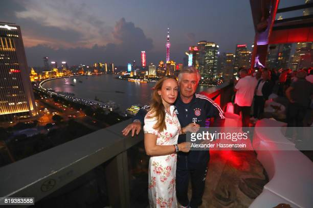 Carlo Ancelotti head coach of FC Bayern Muenchen poses with his wife Mariann Barena McClay for a picture with the Shanghai Bund in the background...