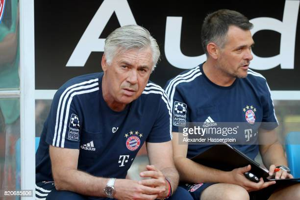 Carlo Ancelotti head coach of FC Bayern Muenchen talks to his assistent coach Bixente Lizarazu prior to the International Champions Cup Shenzen 2017...
