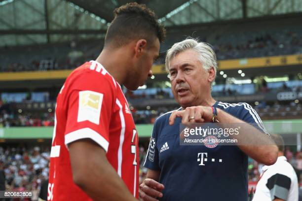 Carlo Ancelotti head coach of FC Bayern Muenchen talks to his palyer Corentin Tolisso during the International Champions Cup Shenzen 2017 match...