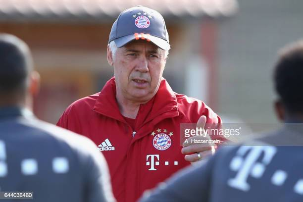 Carlo Ancelotti head coach of FC Bayern Muenchen talks to his players prior to a training session at Saebener Strasse training ground on February 23...