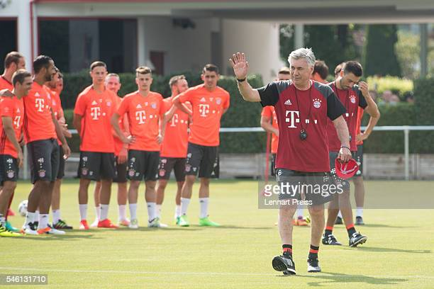Carlo Ancelotti head coach of FC Bayern Munich waves to the fans ahead of a training session of FC Bayern Muenchen at Saebener Strasse training...