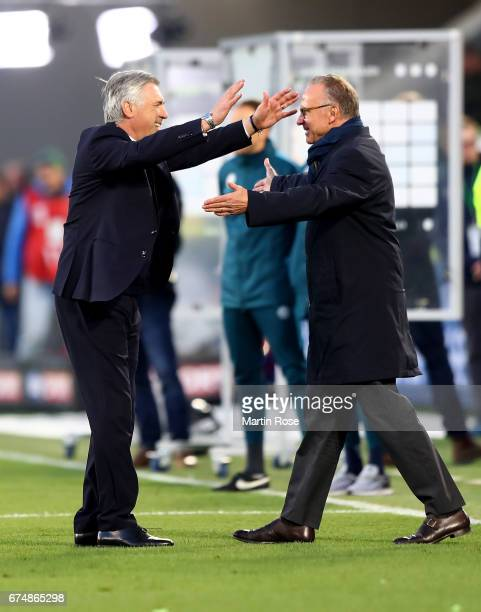 Carlo Ancelotti head coach of Muenchen celebrate KarlHeinz Rummenigge CEO of Muenchen during the Bundesliga match between VfL Wolfsburg and Bayern...