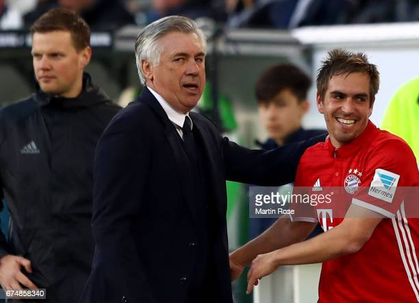 Carlo Ancelotti head coach of Muenchen celebrate with Philipp Lahm of Muenchen during the Bundesliga match between VfL Wolfsburg and Bayern Muenchen...