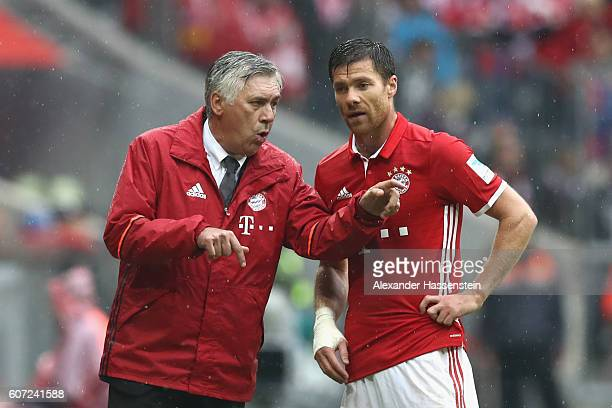 Carlo Ancelotti head coach of Muenchen gives instructions to his player Xabi Alonso during the Bundesliga match between Bayern Muenchen and FC...