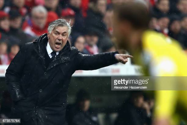 Carlo Ancelotti head coach of Muenchen reacts during the DFB Cup semi final match between FC Bayern Muenchen and Borussia Dortmund at Allianz Arena...