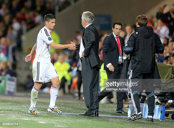 Carlo Ancelotti manager / head coach of Real Madrid shakes the hand of James Rodriguez of Real Madrid as he is substituted