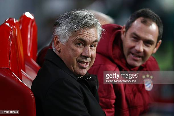 Carlo Ancelotti manager of Bayern Muenchen and assistant Paul Clement look on prior to the UEFA Champions League Group D match between PSV Eindhoven...