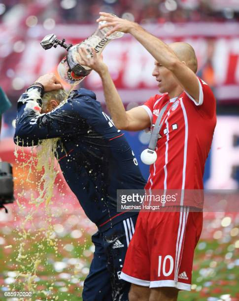 Carlo Ancelotti Manager of Bayern Muenchen is showered in beer by Arjen Robben of Bayern Muenchen following the Bundesliga match between Bayern...
