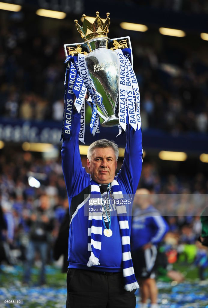 Carlo Ancelotti manager of Chelsea celebrates with the trophy as they win the title after the Barclays Premier League match between Chelsea and Wigan Athletic at Stamford Bridge on May 9, 2010 in London, England. Chelsea won 8-0 to win the championship.
