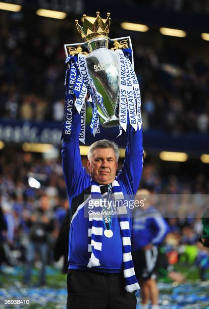 Carlo Ancelotti manager of Chelsea celebrates with the trophy as they win the title after the Barclays Premier League match between Chelsea and Wigan...
