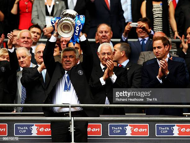 Carlo Ancelotti manager of Chelsea holds the trophy aloft following his sides victory in the FA Cup sponsored by EON Final match between Chelsea and...